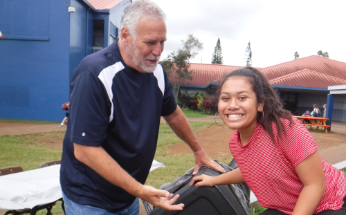 Kalama student and staff member assist with school activity