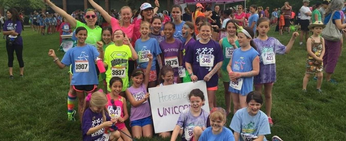 The Hopewell Unicorn running team celebrate their accomplishments at a race