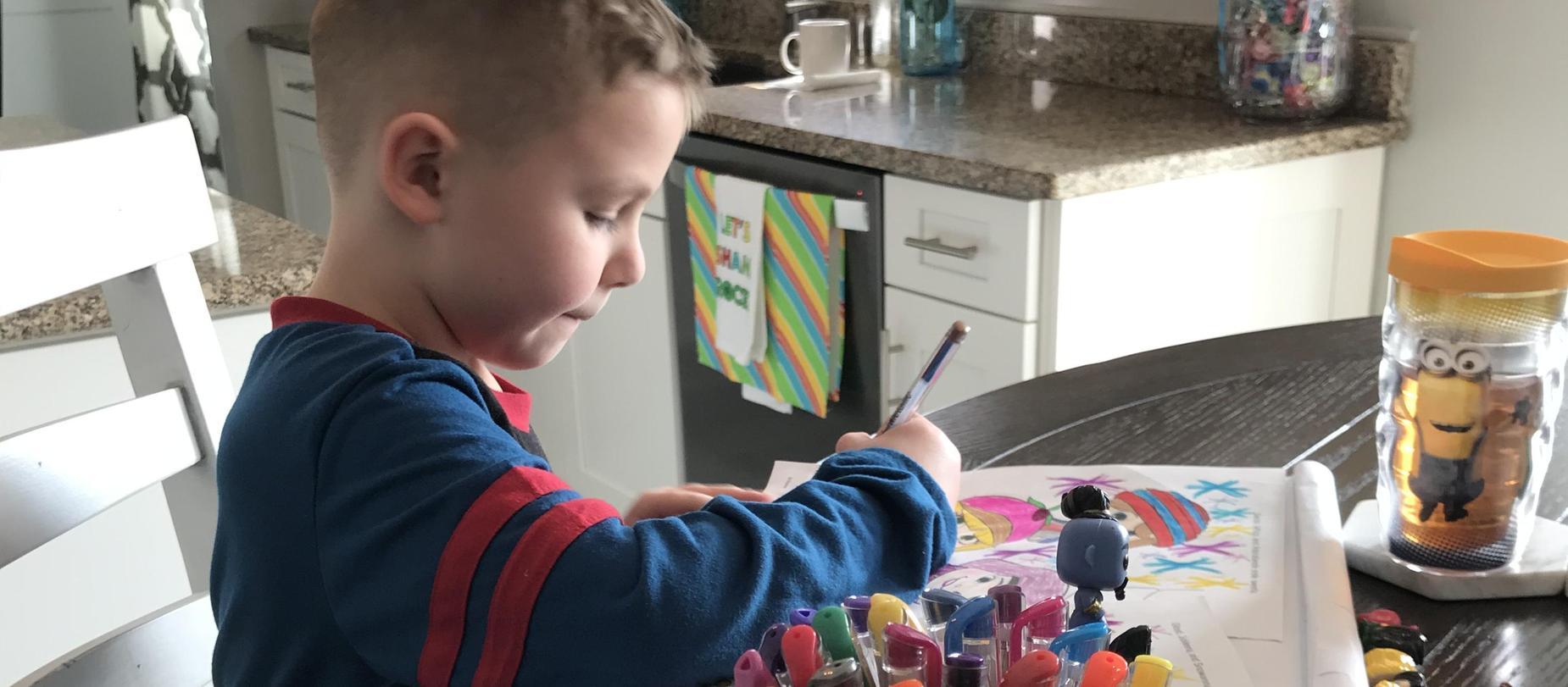 student doing art work