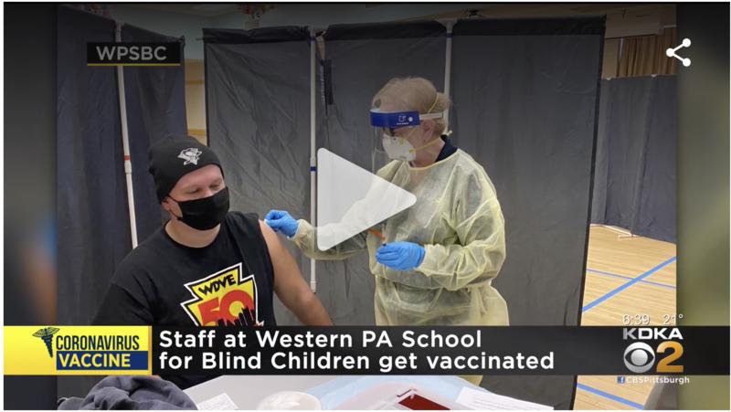 Screenshot of WPSBC staff member receiving COVID-19 vaccine.