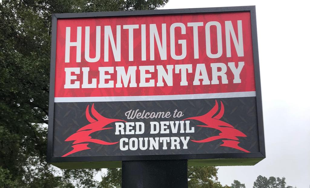 Sign of Red Devil County in front of the Elementary school