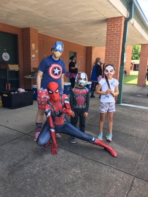4 people in super hero costumes