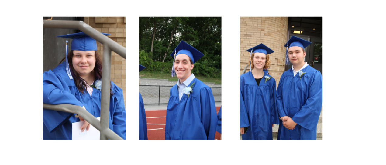 students in cap and gown smiling