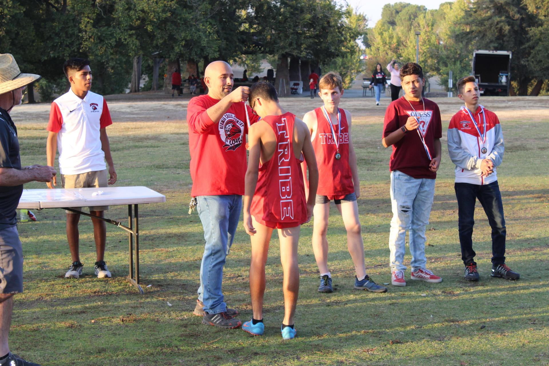 JV Boys First Place Medal is awarded.