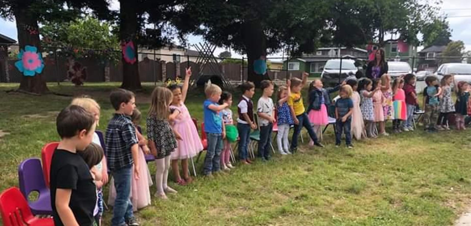 Children standing at Graduation time
