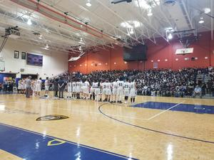 boys and girls teams on the court facing the audience