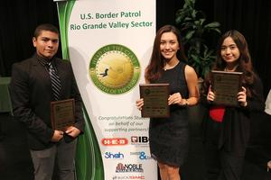 three students with awards