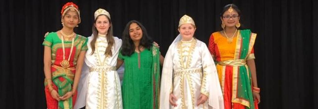 Multicultural Fashion Show - Students dressed in their native clothes.