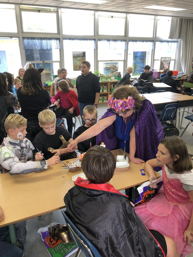 Students face painting with Mrs. Calkins during the Fall Festival