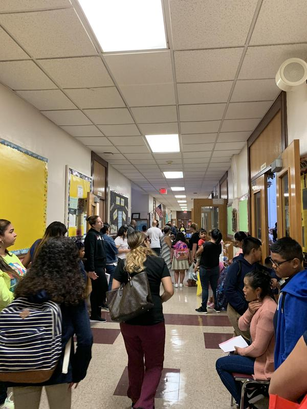 students and parents in the hallway