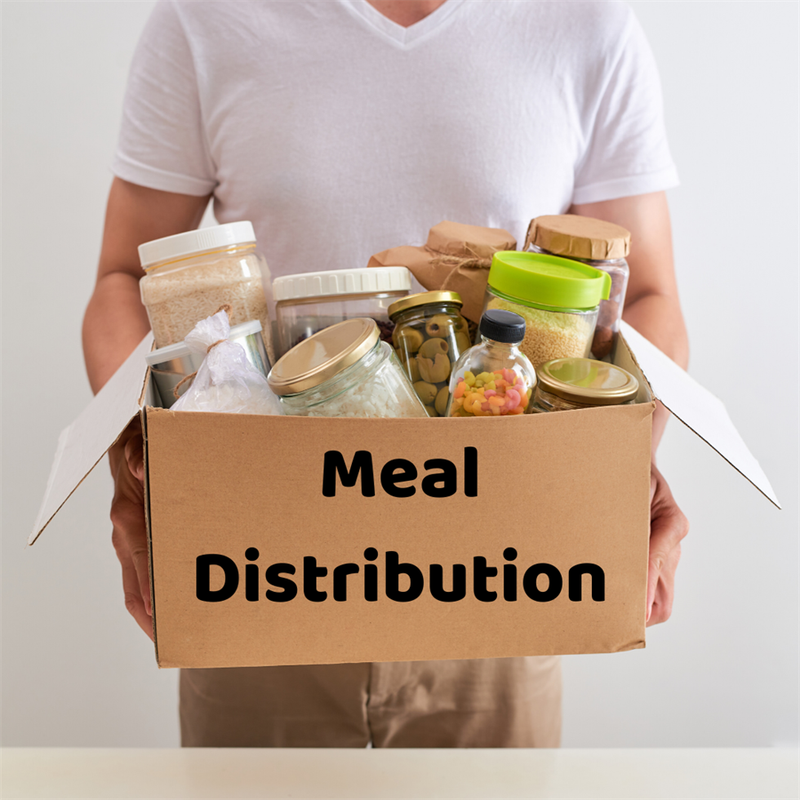 Person holding box of food