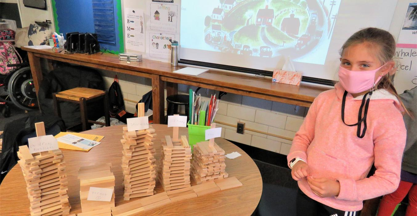 Lee students use Keva Planks to create different kinds of communities.