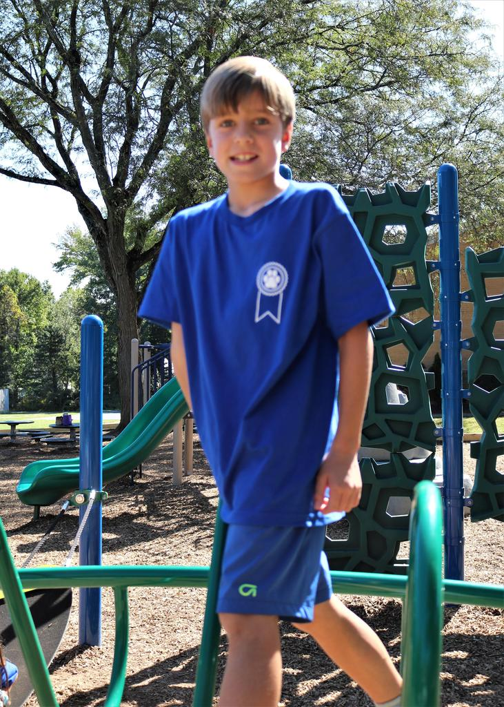 Photo of Washington School student wearing special National Blue Ribbon School shirts.