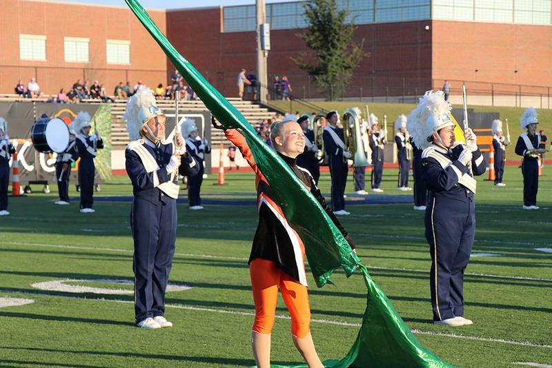 color guard and band on the field