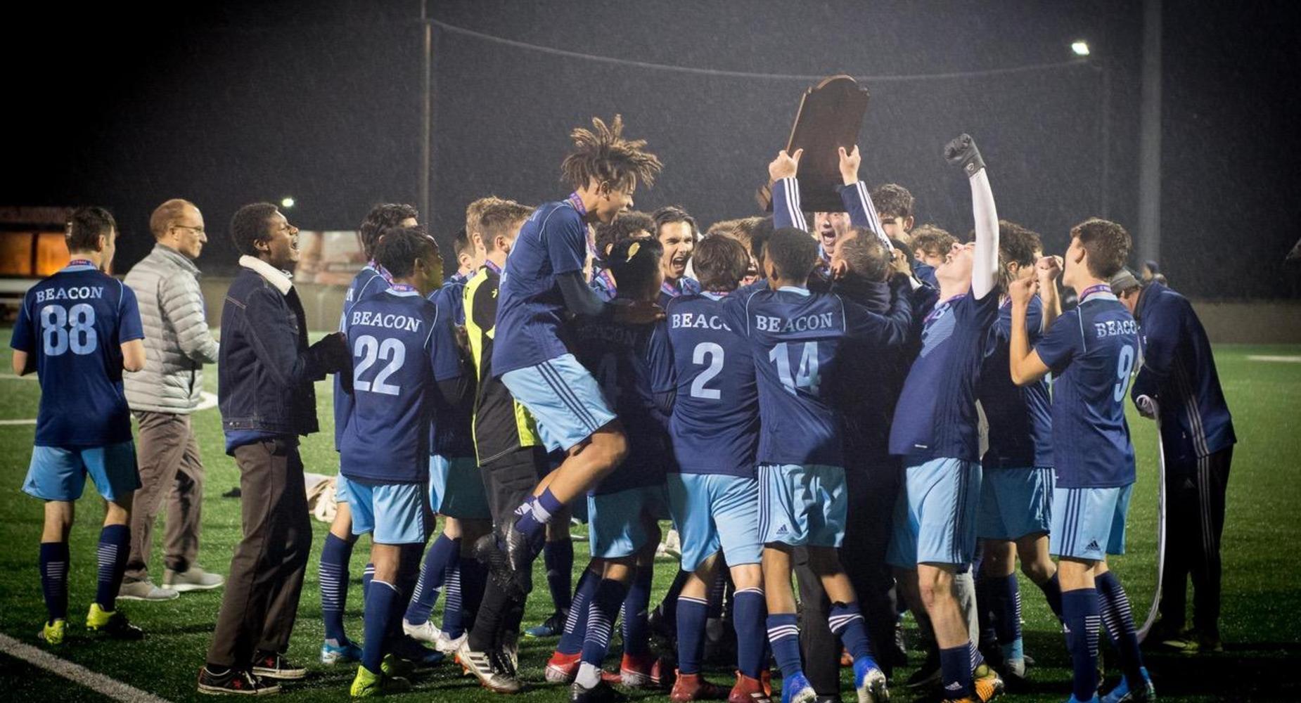 Beacon's Soccer Team celebrates the Finals