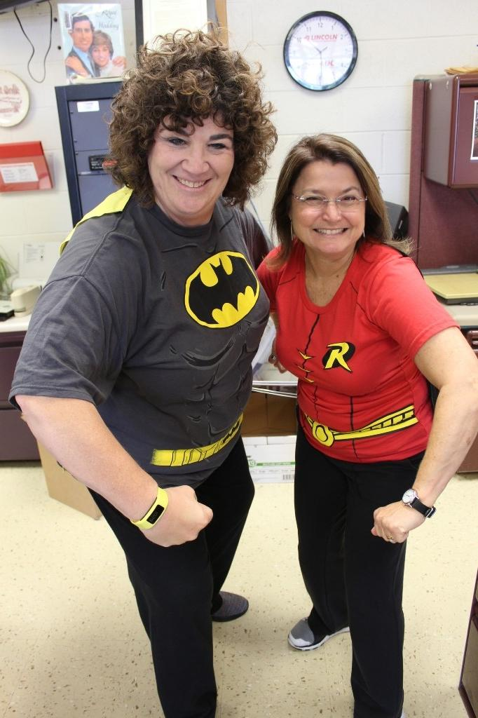 Office staff as Batman and Robin