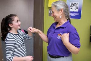 Robin Adrian-Murray Welcoming a student to her classroom
