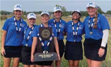 girls golf team with trophy