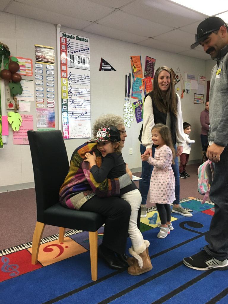 reader and incoming student share hug