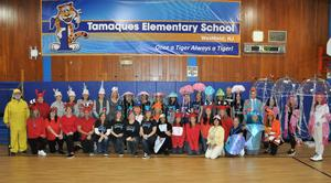 Group shot of Tamaques staff dressed as various ocean creatures with principal David Duelks as fisherman.