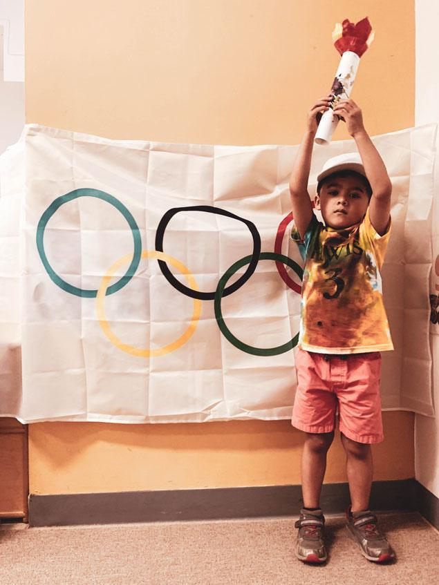 HWIS Immersion Summer Camp HudsonWay Olympian Poses with His OIympic Torch