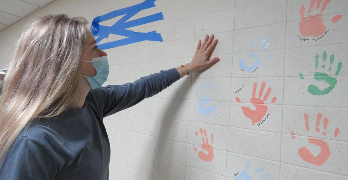 TKHS Class of 2021 leaves their handprints on the wall.
