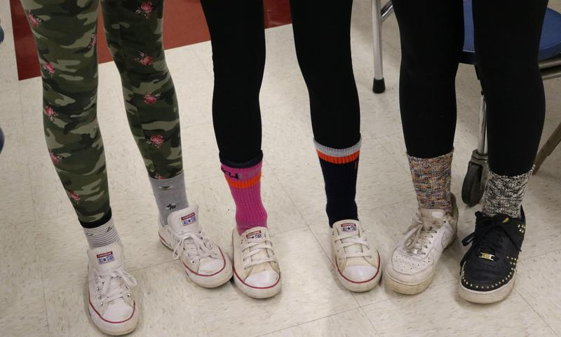 Photo of mismatched socks and shoes of Roosevelt students on Mix It Up Day.