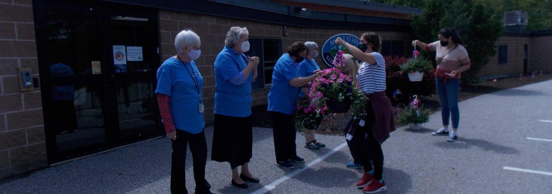 retirees receive flowers