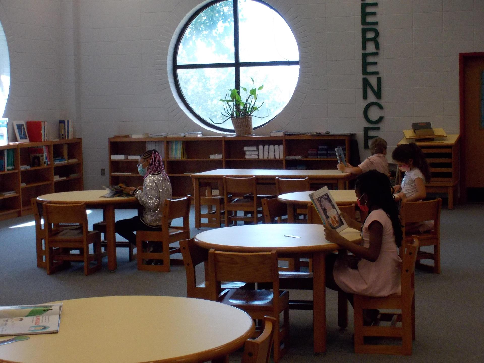 Reading at the tables in the library