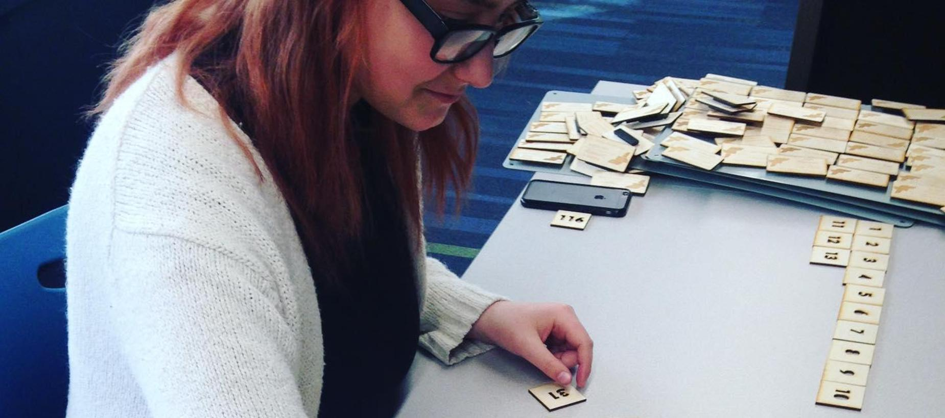Student with laser cut numbers