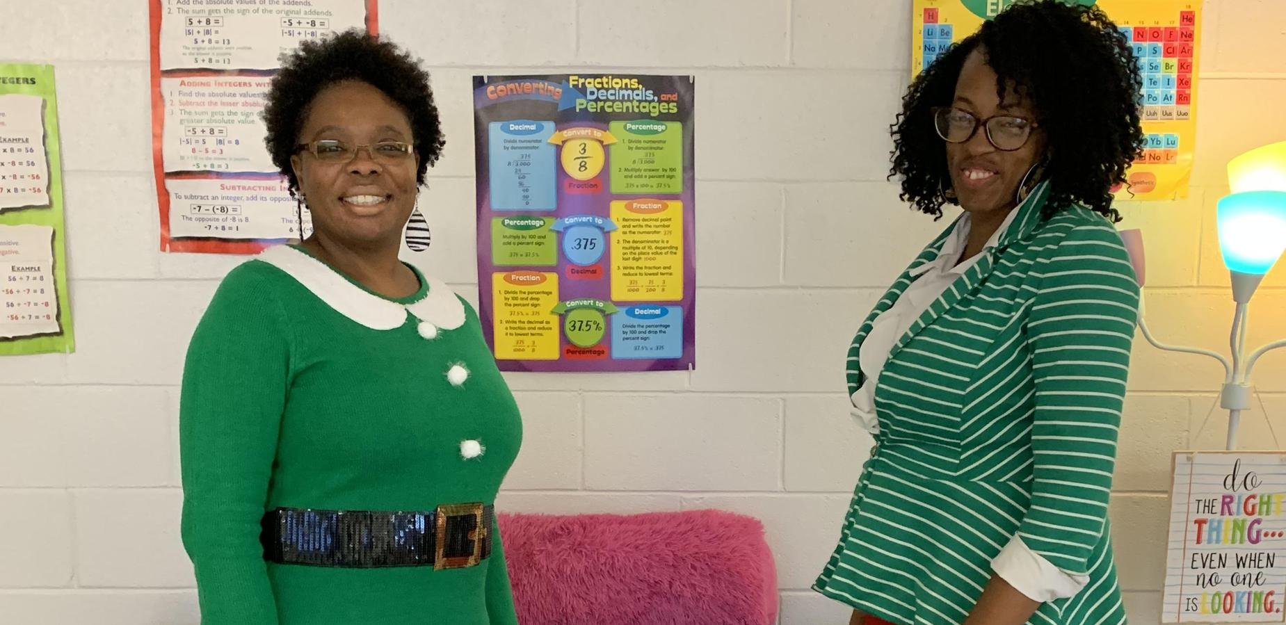 Mrs. Pauling and Ms. Ginyard wearing festive green attire