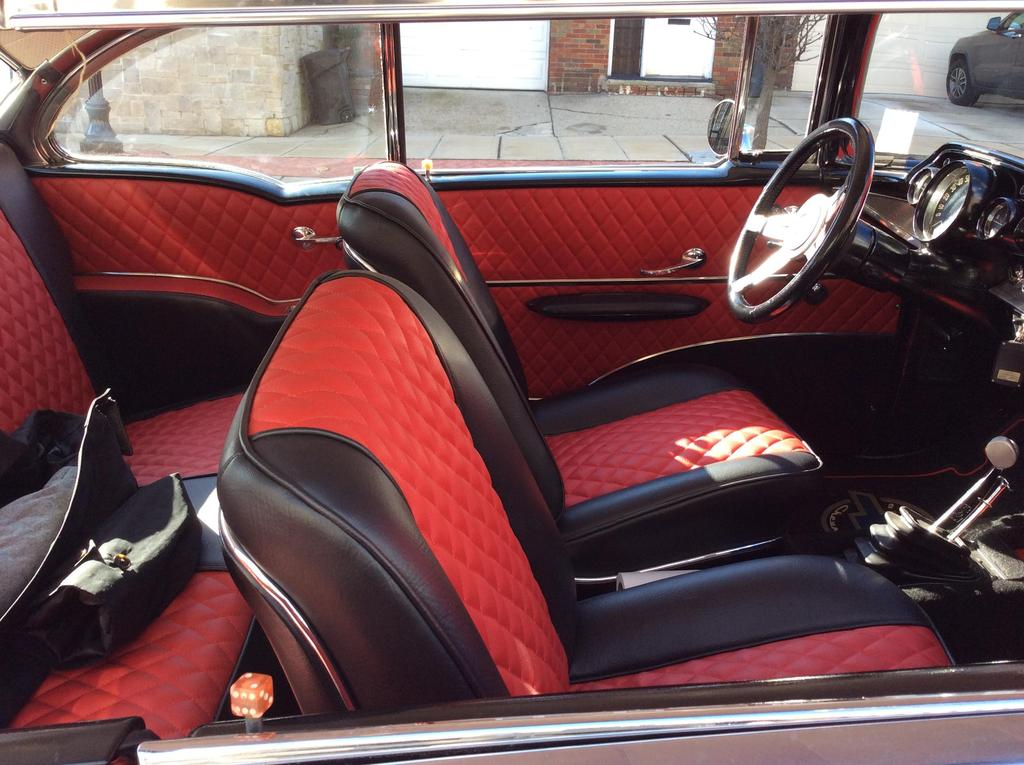 Red with black leather detail inside of 1957 Red Chevy