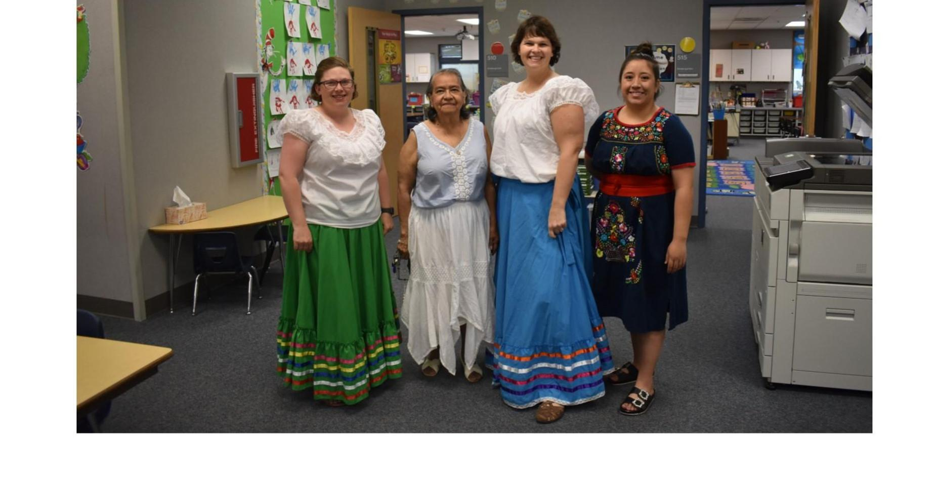 Four of our kindergarten teachers dressed up for cultural dress day.