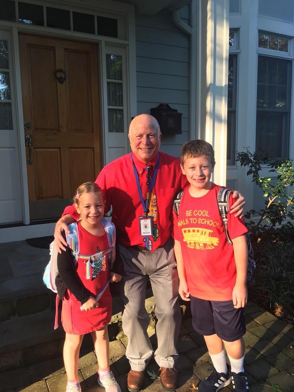 Washington principal Andrew Perry escorts students on Walk to School Day.