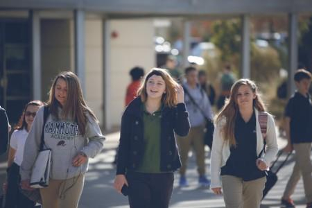 Three female students walking together