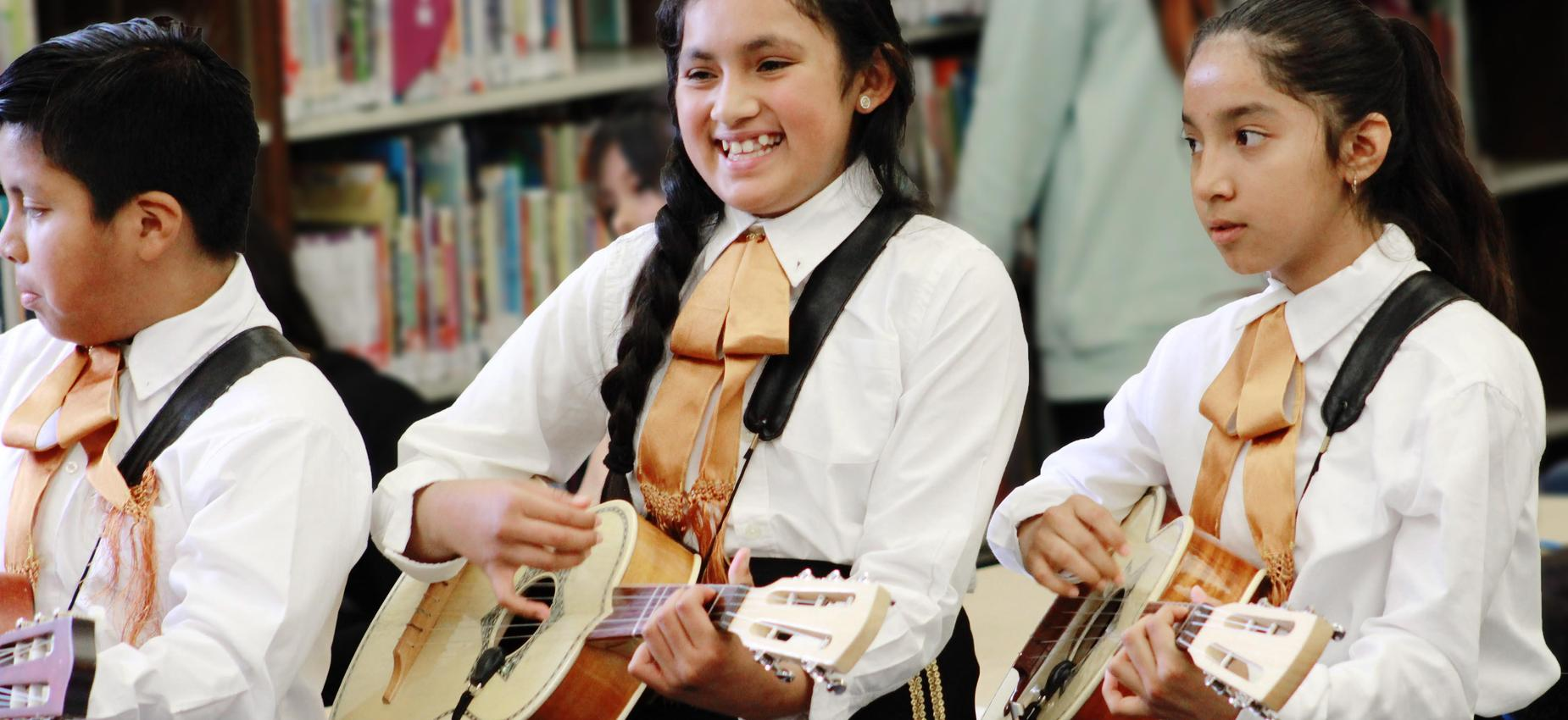 Roosevelt students playing instruments