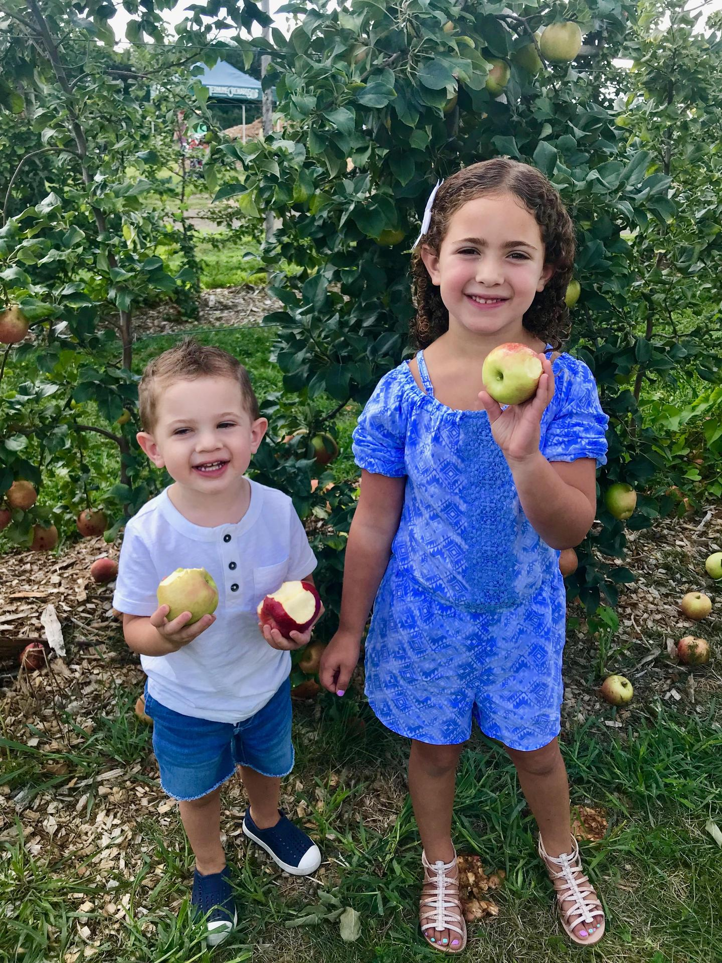 Emery and Cam apple picking