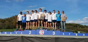 boys cross country team on the state podium