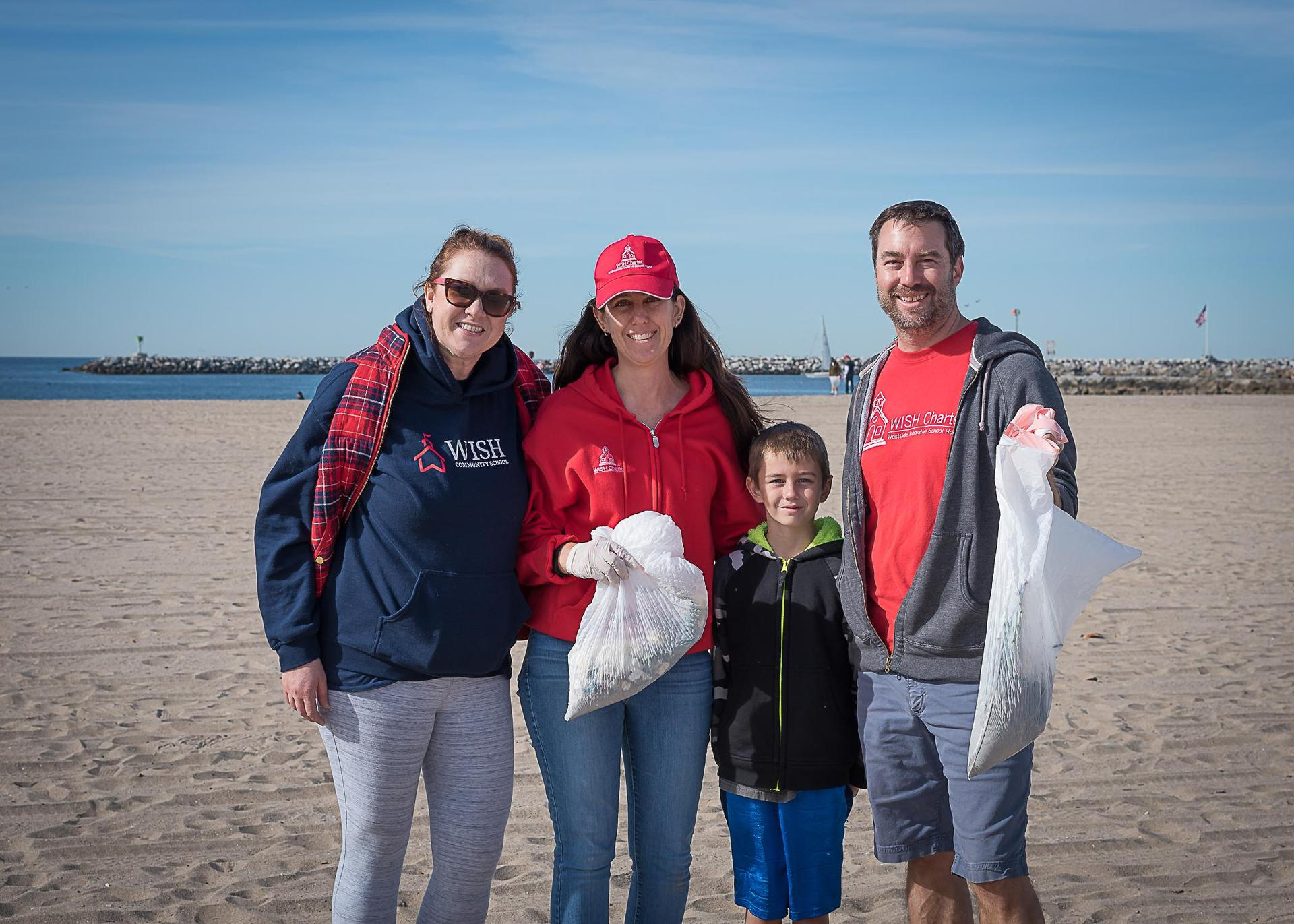 Parent volunteering at the beach clean-up