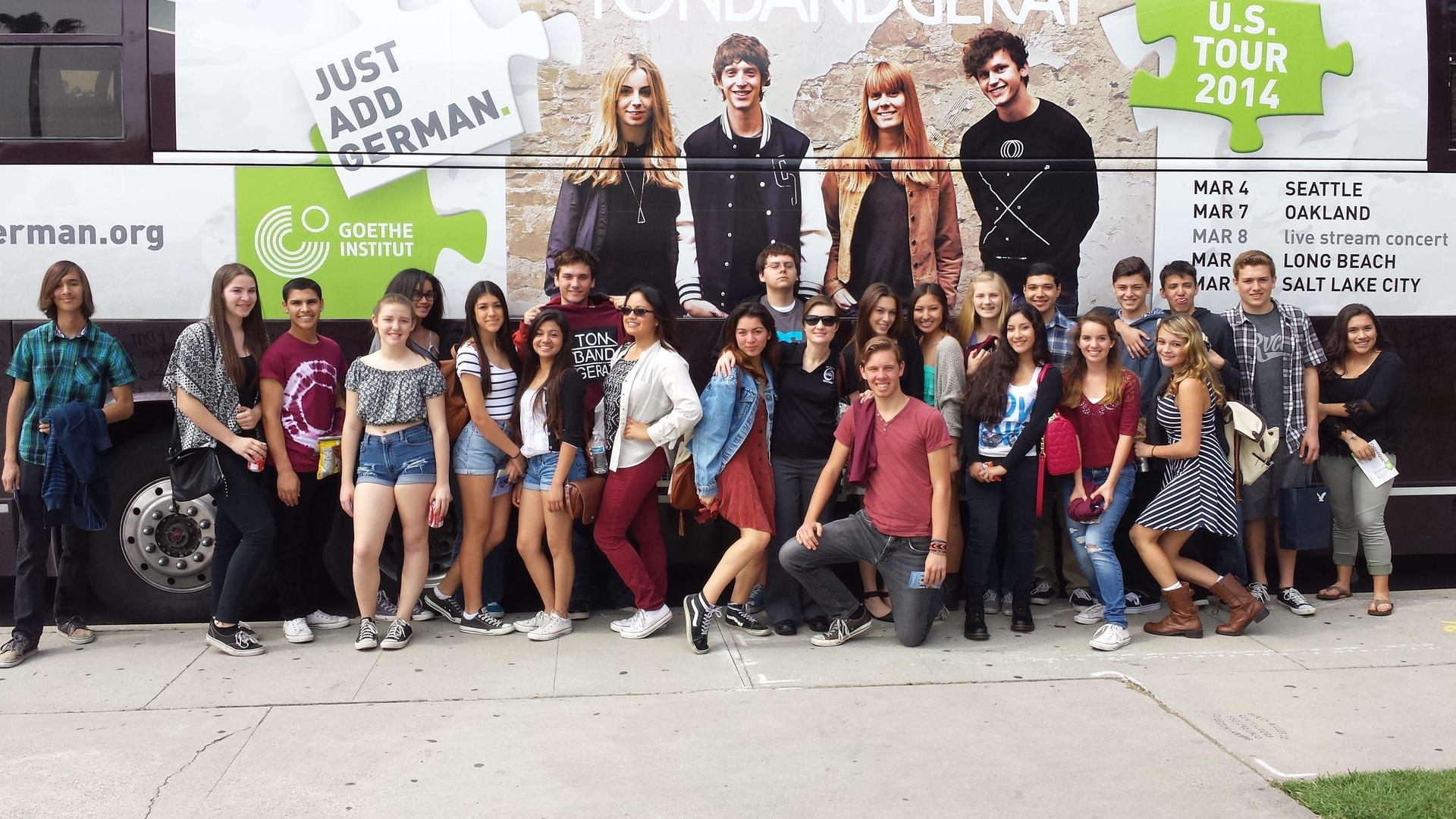 Group photo in front of the band's tour bus