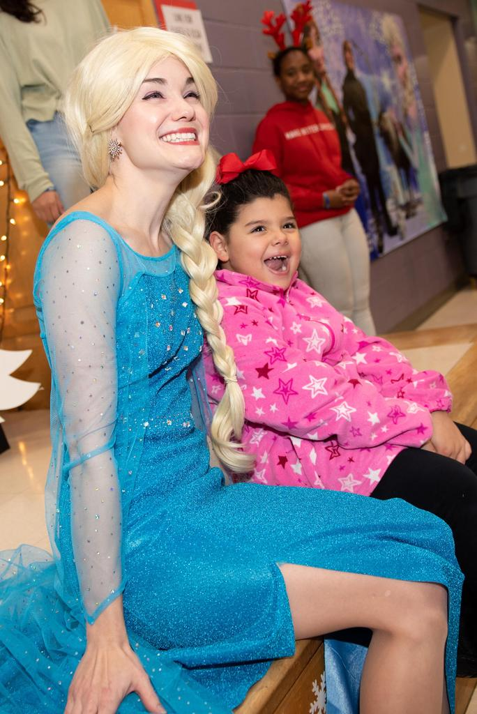 """Elsa from """"Frozen"""" sits with a student at the end of the stage"""