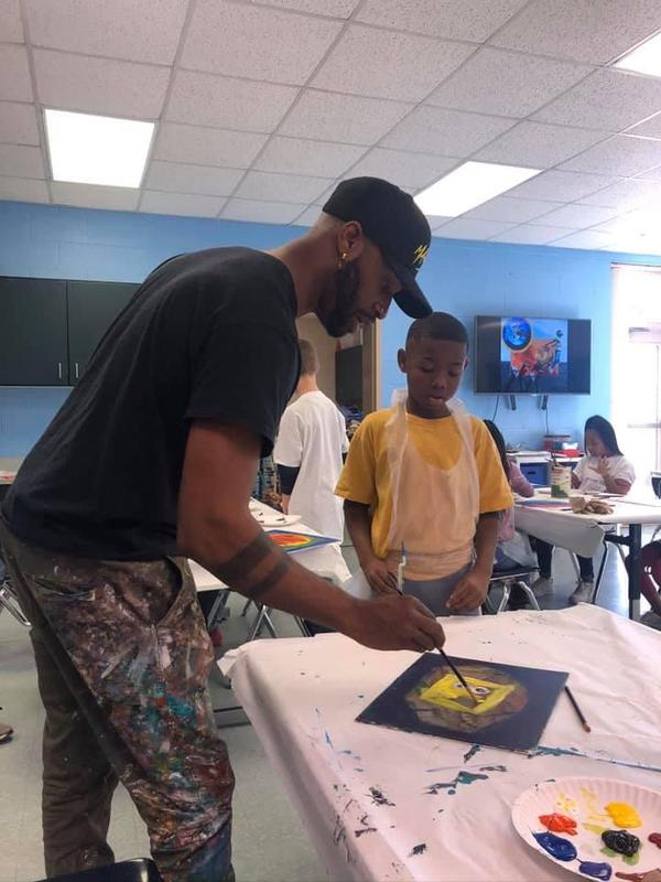 Cardell and student painting