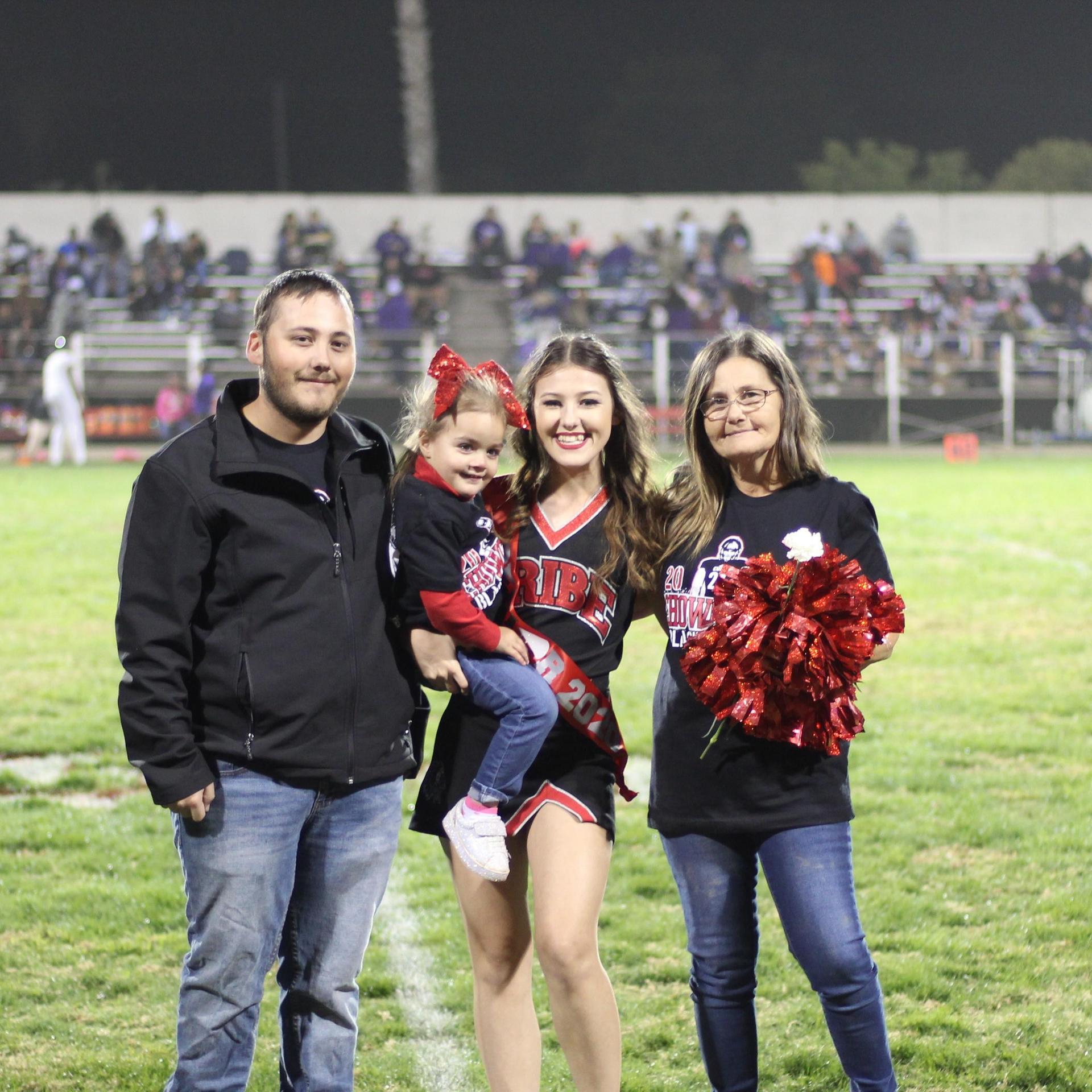Senior cheerleader Kaylynn Matthes and her escorts.