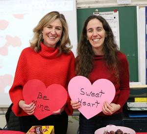 Photo of two McKinley parents who organized a class party for Valentine's Day.