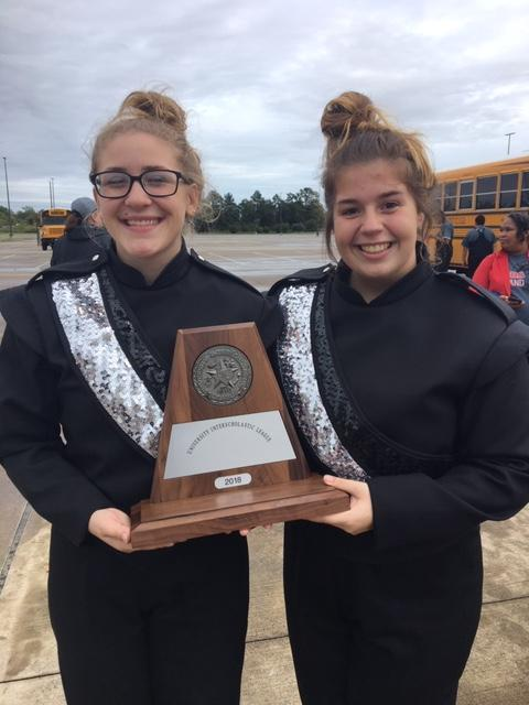 Photo of Band members with UIL Marching Band 1st Division trophy