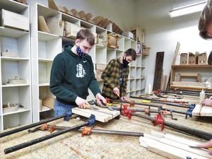 TKHS woods students work on making cutting board out of various pieces and types of wood.