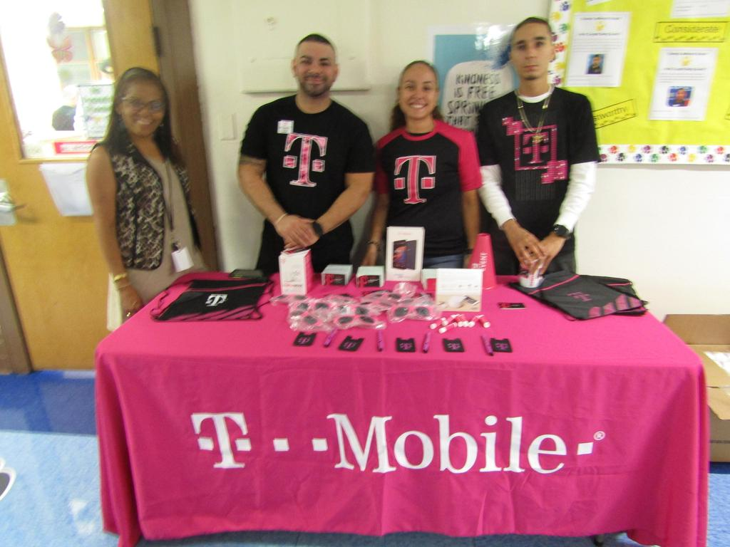 Tmobile representative with school parent liaison mrs fansisco at their display table