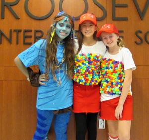 Photo of students dressed as gumball machines for Halloween.