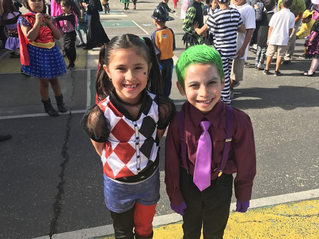 Two students in costume smiling