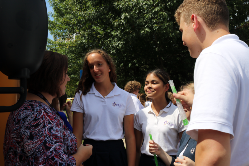Caitlin Snatchko talks with OLSH students at the 2018 Back to School party